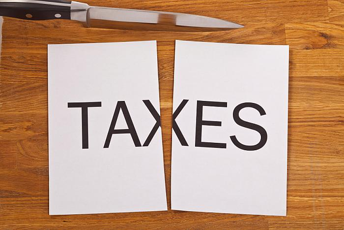 kozzi-24776523-split taxes-883x588