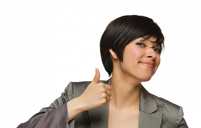 kozzi-5640824-happy young mixed race woman with thumbs up on white-903x575