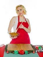 kozzi-young woman mixing christmas cookie paste-624x832