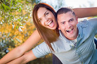 kozzi-mixed race romantic couple portrait in the park-886x586