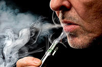 kozzi-close up portrait of a man smoking an e-cigarette-888x585