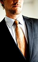 kozzi-4955404-welldressed businessman closeup of suit-568x914