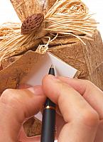 kozzi-24877343-writing a message on a gift tag-1232x1704