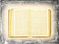 kozzi-10171101-Close-up of opened book pages against vintage background-833x624