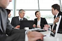 kozzi-3100322-group of business people at meeting in office-1776x1182